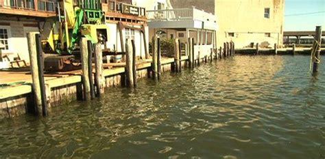 sinking boat put in bay rising seas sinking land put maryland s waterfront