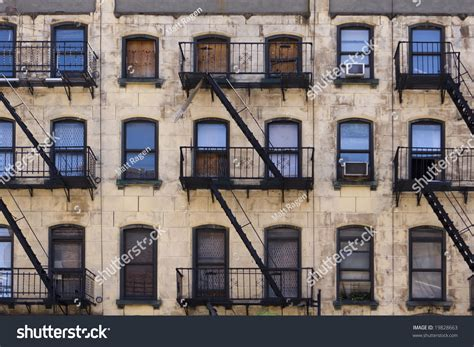 Apartment Building Search Nyc Three Floors Of Windows With Escapes On The Facade Of
