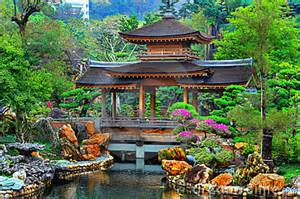 pagoda in front of a pond in a beautiful chinese garden