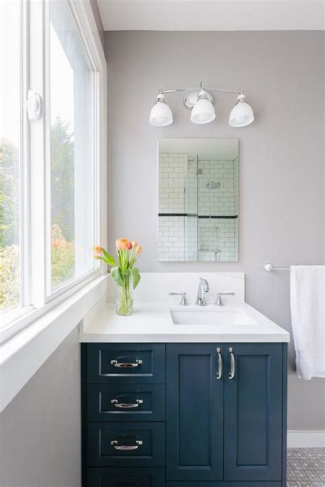 navy bathroom vanity with frameless mirror contemporary