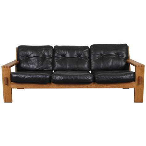 mid century modern black leather oak sofa by esko