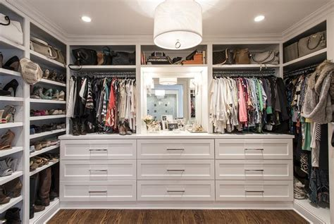 Built In Walk In Closets by Lovely Walk In Closet With Built In Dressers And Jonathan Adler Meurice Drum Pendant By Rock