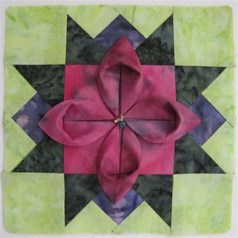 Origami Fabric Flowers - folded flower block this wish there were