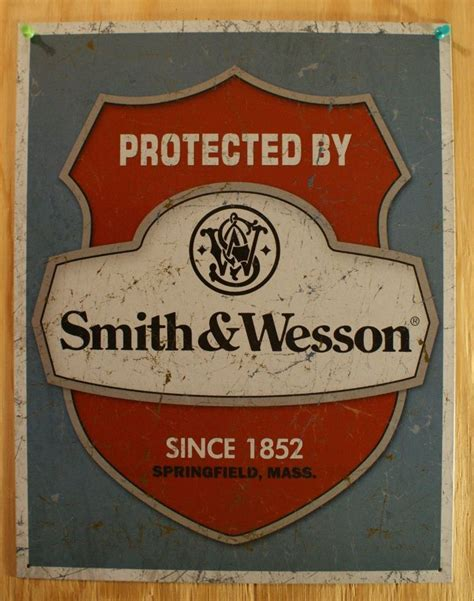 protected by smith wesson tin sign ammo gun home