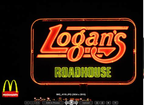 logan s roadhouse signage at h town west photo