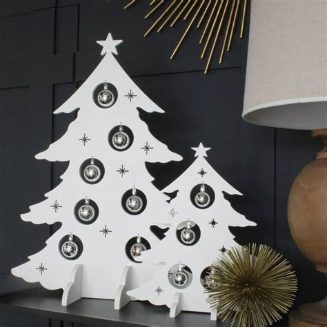 white alternative wooden christmas trees by ella james