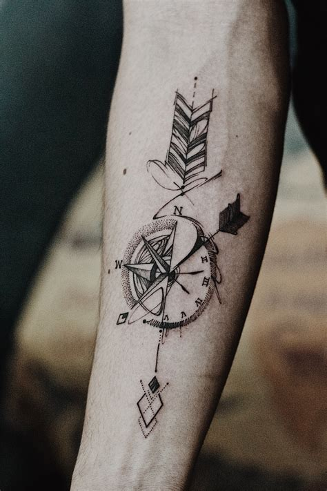 arrow compass tattoo artwork by outsider tattoo