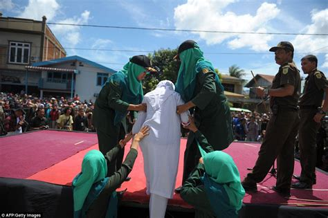 About Aceh And East Timor Banned By Government by Unmarried Couples Are Flogged For Violating Sharia In