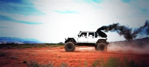 rattletrap jeep rollin coal jeep rolling some coal cummins turbo diesel power