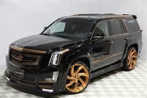 Gold Cadillac Escalade Calwing Cadillac Escalade Goes Black Gold