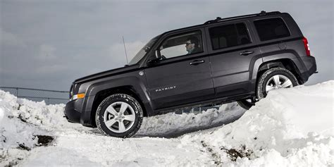 jeep patriot off road off road in the snow with jeep