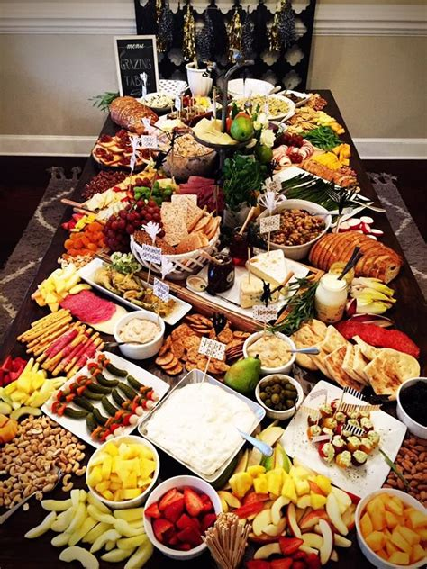 grazing table appetizers table food platters