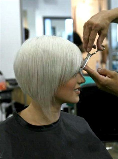 cutting a stacked angled bob inverted stacked bob wedge cut with side swept bangs