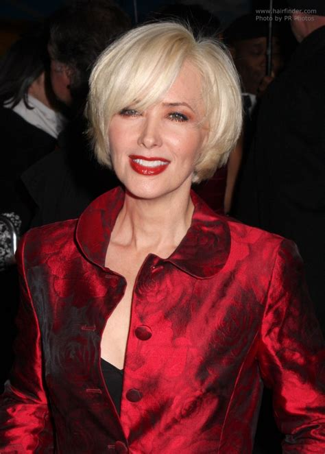 Janine Turner's hair cut into a blonde chin length bob