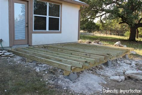 how to build a frame for a porch swing building the deck part i domestic imperfection