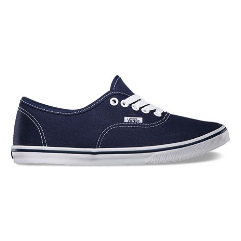 Vans Auntentic Navy Blue agdal puffs on cigarette while bike