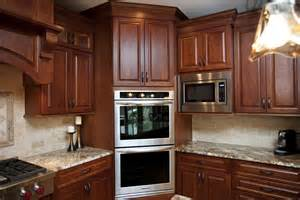 corner oven cherry shaker cabinets staggered