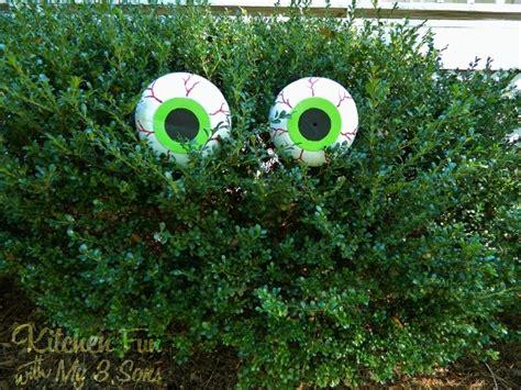 dollar store spooky bush eyes outdoor craftcheap easy