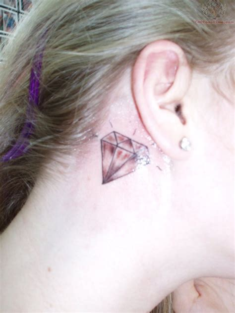 back of ear tattoo and bow