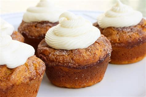 pumpkin spice muffins with cream cheese frosting the