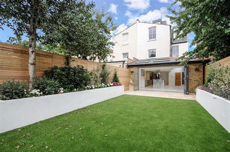 travertine paving patio render block raised beds hardwood modern garden design london artificial grass travertine