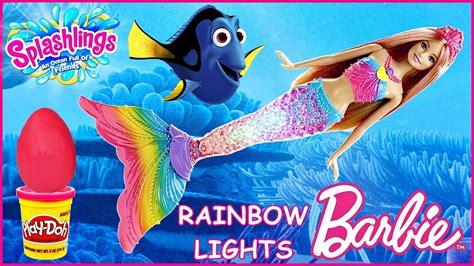 barbie rainbow lights mermaid doll barbie rainbow lights mermaid play doh surprise eggs