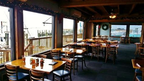 Island House Restaurant by Large Windows Allowing For A Spectacular View Picture Of