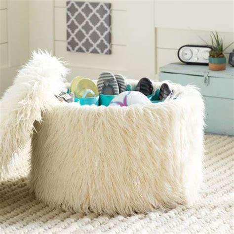 fuzzy white ottoman 4 a fuzzy ottoman doubles as extra shoe storage 349 at