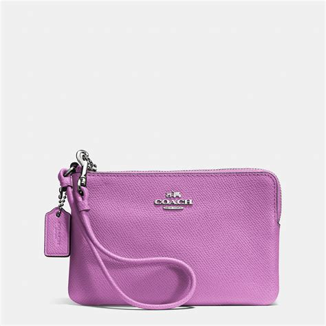 couch wristlet coach embossed small l zip wristlet in leather in pink lyst