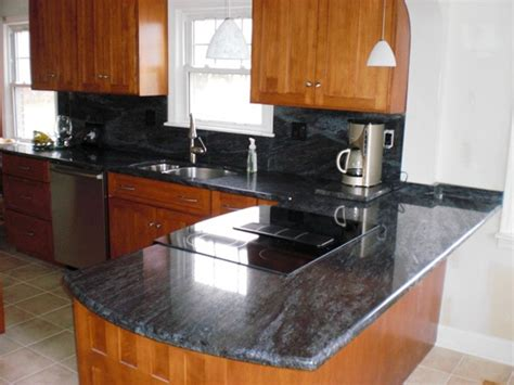 Bross Cherry cherry cabinets with bross blue granite counters