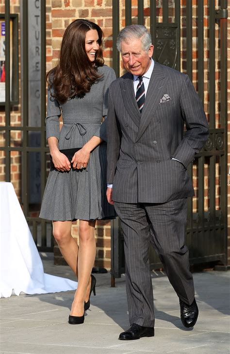 Charles Katy kate middleton in a gray dress with prince charles