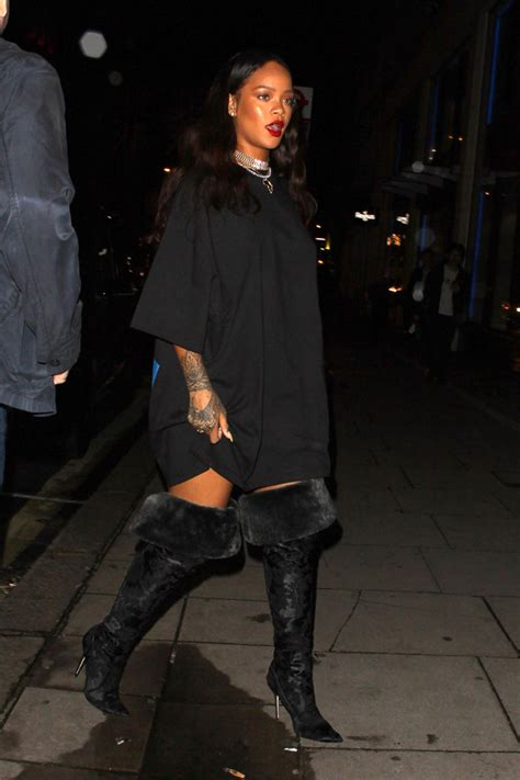 rihanna rocks thigh high boots in footwear news
