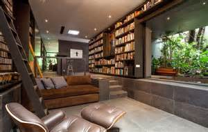 comfy library chairs this gorgeous home is a nature loving bookworm s paradise