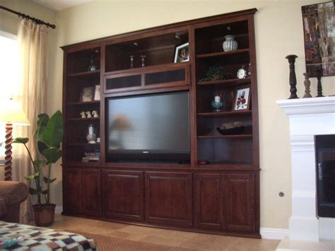 wall cabinet entertainment center get your own custom wall unit built in cabinets by