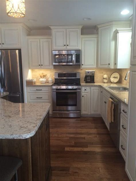 Off white coffee glazed cabinets, walnut stained island