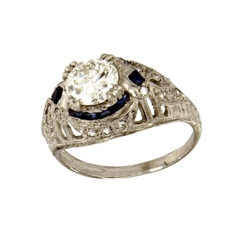 platinum with diamonds surrounded sapphires ring from