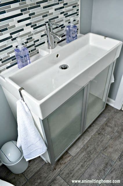 modern sink with towel hooks on both ends and