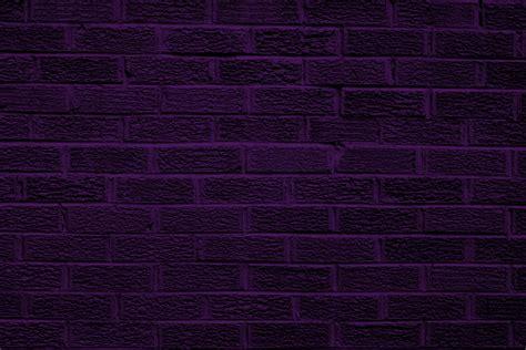 Black wall and dark purple brick wall