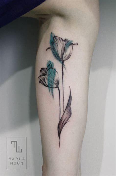tattoo black and blue black and blue tulip tattoo tattoomagz