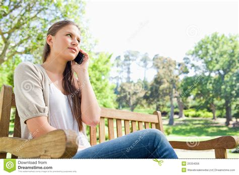 talking bench woman talking on her phone on a bench royalty free stock image image 25334056