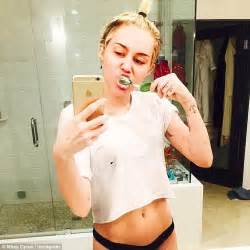 miley cyrus skinny instagram pic fans react to bony miley cyrus posts sexy selfie posing in cropped tee and