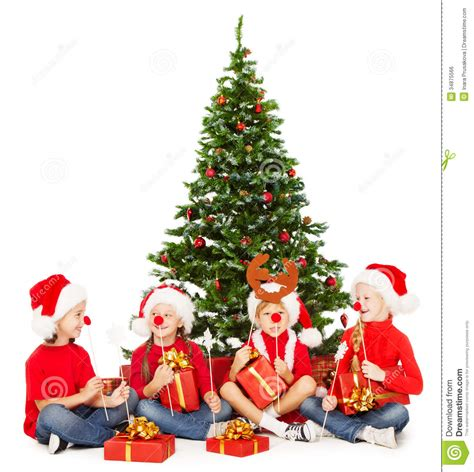 christmas helpers kids playing under fir tree new royalty