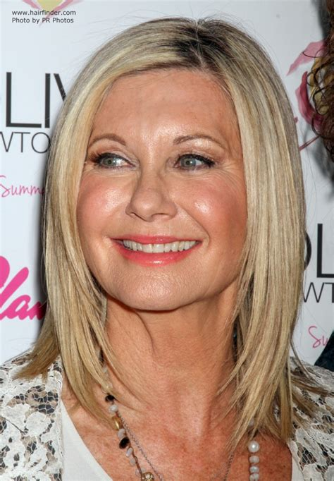 olivia newton johns physical haircut olivia newton john over age 65 and wearing her hair smooth