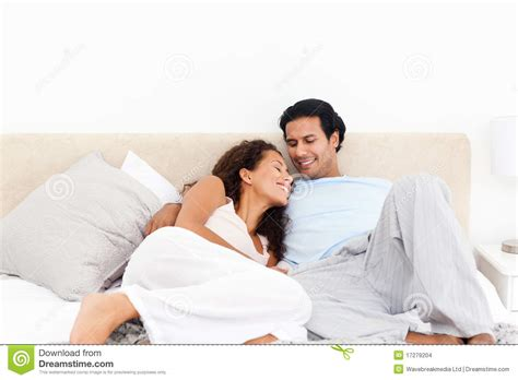 in their bedroom lovely hispanic couple relaxing in their bedroom stock images image 17279204