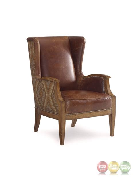 Aztec Chair by The Foundry Antique Brown Aztec Wingback Chair With Nail Trim