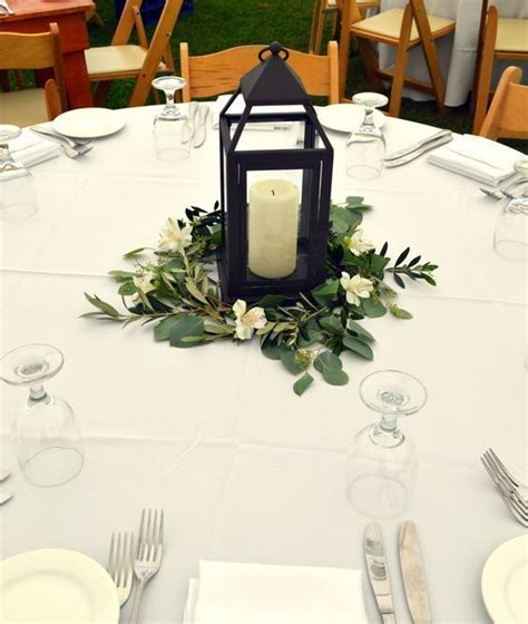 Olive Garden Utica Ny by Vintage Lantern Wedding Centerpiece Surrounded By White