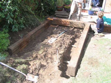 Laying Garden Sleepers how to build a raised pond with railway sleepers