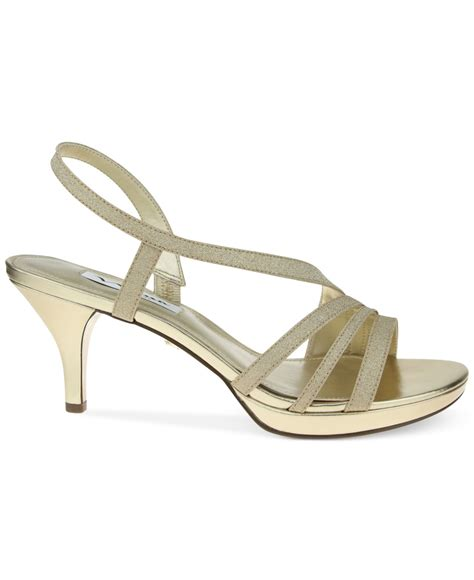 gold evening sandals neely asymmetircal evening sandals in gold lyst