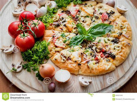 large pizza table large pizza stock photo image 65051543