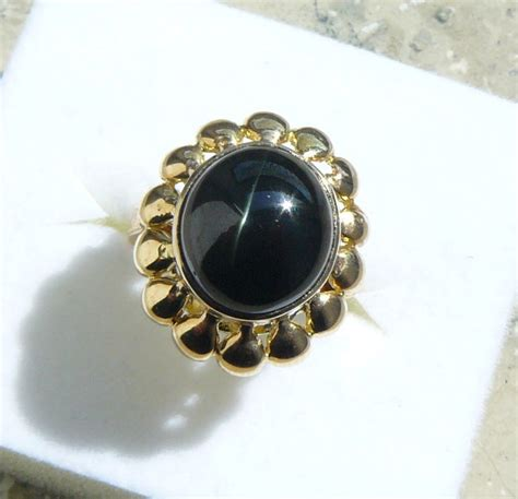 golden black sapphire 21 20ct yellow golden ring with black sapphire catawiki